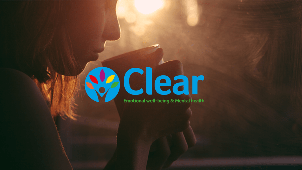 Clear logo with a background of someone in a calm environment drinking from a mug