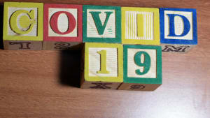 Covid 19 spelled out in childrens play blocks